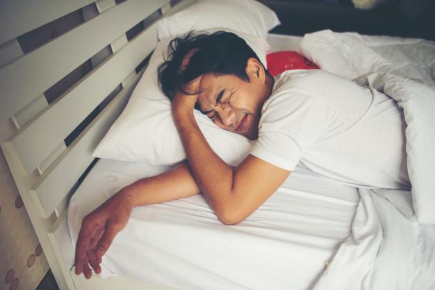 man-sleeping-bed-morning_1150-5036